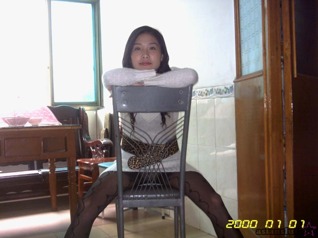 charming Chinese young wife in white dress showing off her naked body and dirty pussy